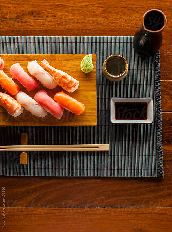 Sushi and Sake Served in a Japanese Restaurant by Mosuno for Stocksy United