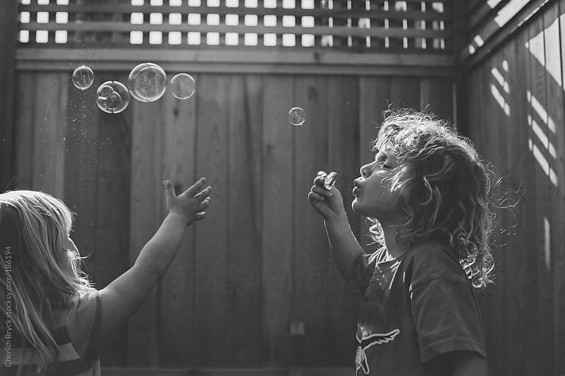 Blowing Bubbles. by Cherish Bryck for Stocksy United