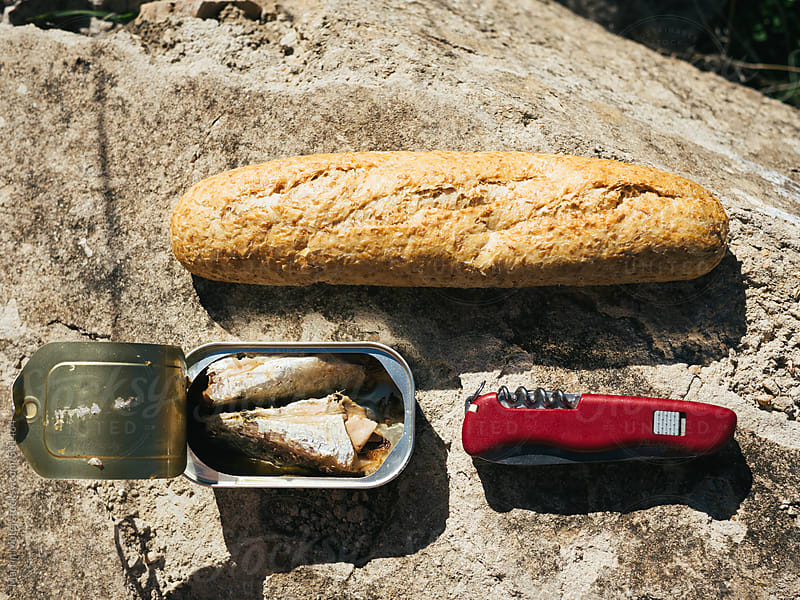 Picnic of sardines, roll and swiss knife by Martin Matej for Stocksy United
