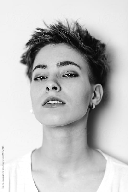Studio portrait of beautiful shorthair woman by Boris Jovanovic for Stocksy United