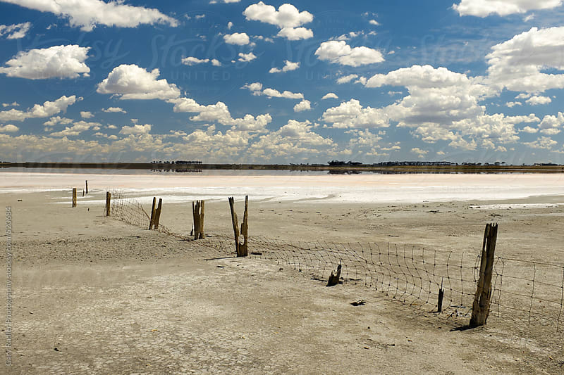 Fence on Dry Lake Bed by Gary Radler Photography for Stocksy United