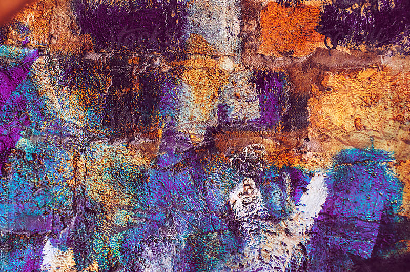 Vibrant painted wall with different brush strokes/colors; colorful painted wall background/texture by Wizemark for Stocksy United