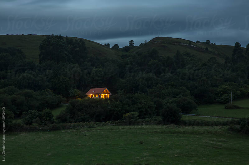 A solitude house at dusk by Luis Cerdeira for Stocksy United
