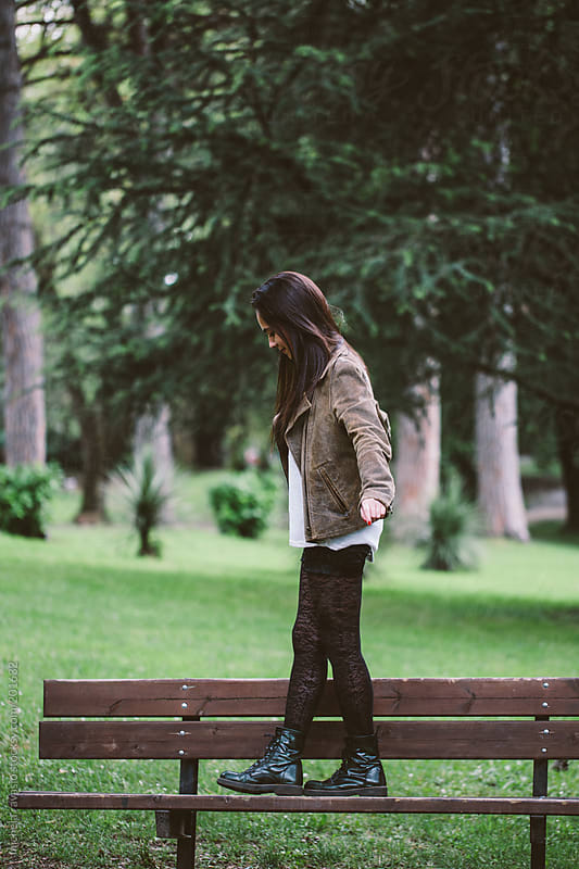Teenage girl having fun at the park by michela ravasio for Stocksy United