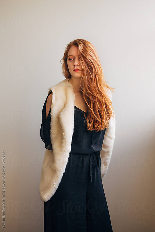 Beautiful redhead girl under natural light by Maximilian Guy McNair MacEwan for Stocksy United