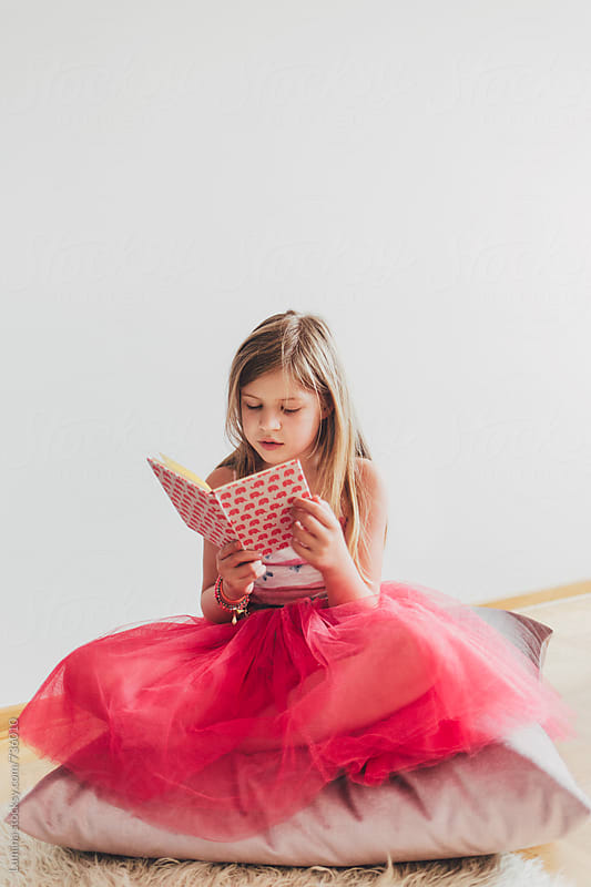 Little Girl Reading a Book by Lumina for Stocksy United