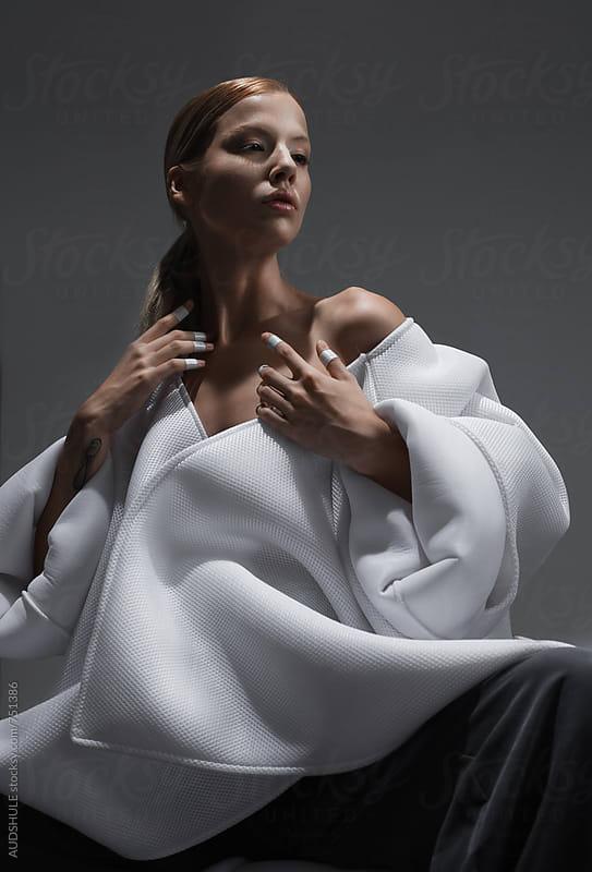 Conceptual portrait of caucasian fmeal in wihte kimono/fashion by Audrey Shtecinjo for Stocksy United