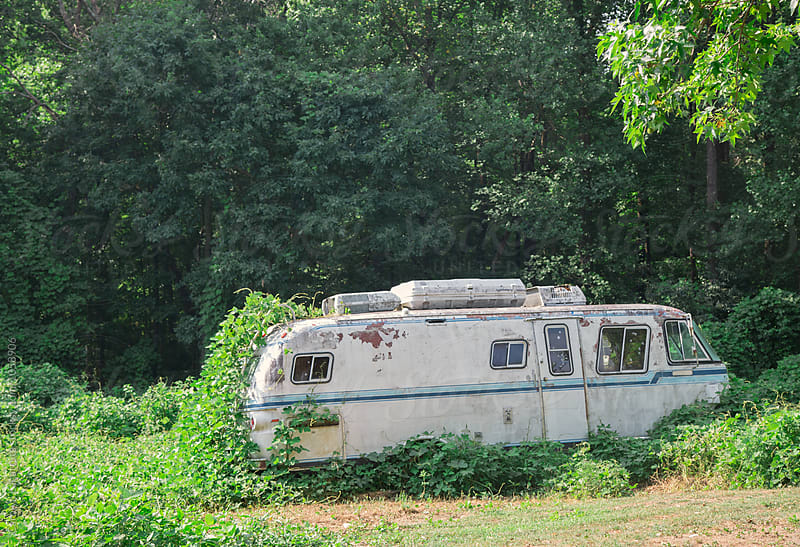 Abandoned camper being taken over by kudzu by Carolyn Lagattuta for Stocksy United