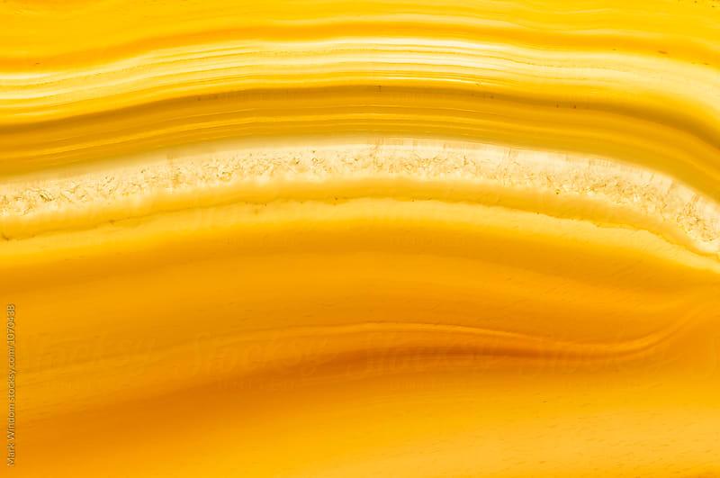 Backlit agate banding, macro by Mark Windom for Stocksy United