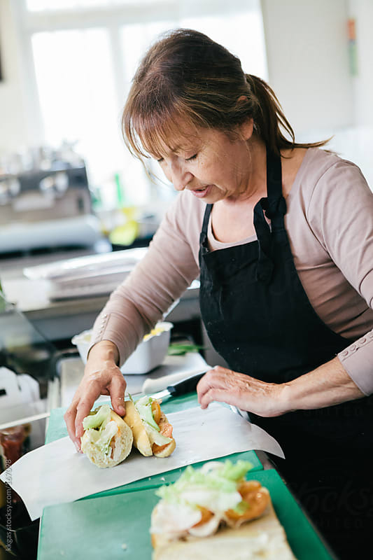 Woman working in a bakery making sandwiches  by kkgas for Stocksy United