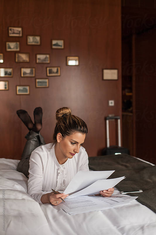 Businesswoman Working in a Hotel Room by Mosuno for Stocksy United