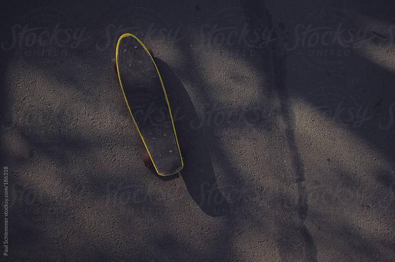 yellow penny skateboard  by Paul Schlemmer for Stocksy United