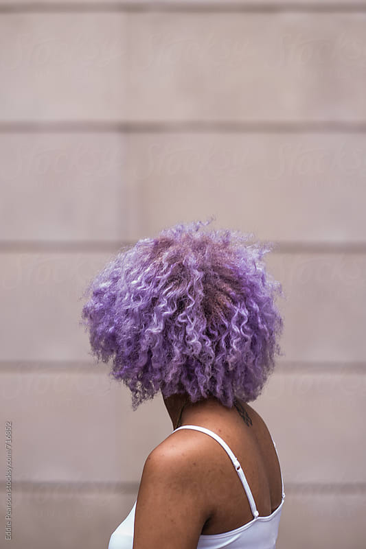 Rear shot of a woman with purple hair by Eddie Pearson for Stocksy United