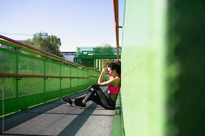 Woman resting after a run by michela ravasio for Stocksy United
