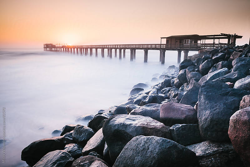 Long Exposure of Swakopmund jetty at sunset by Micky Wiswedel for Stocksy United