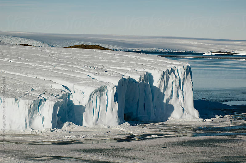 Glacier edge and sea ice, Antarctica. by Thomas Pickard for Stocksy United