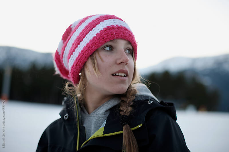 Portrait of a young girl in a winter resort by Miquel Llonch for Stocksy United
