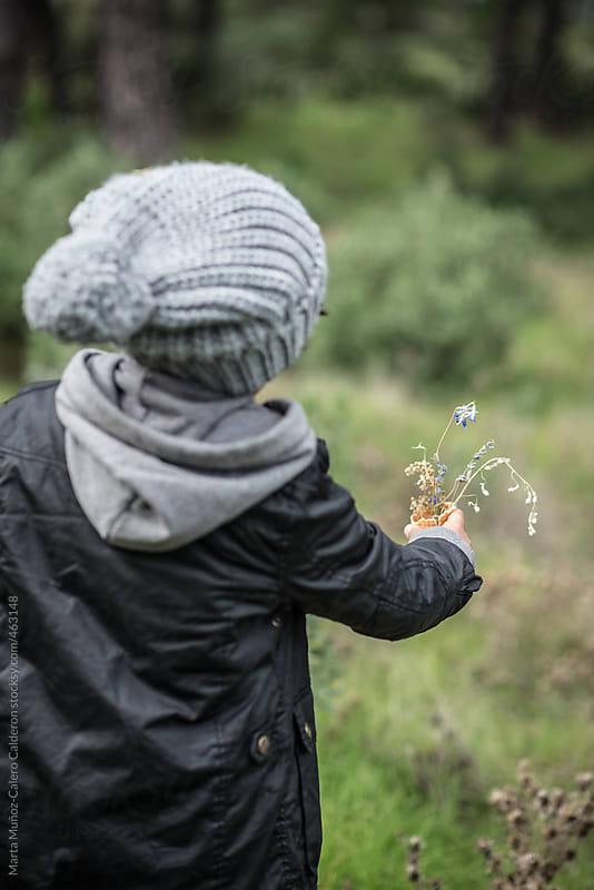 Boy delivering an icecream cone full of  flowers by Marta Muñoz-Calero Calderon for Stocksy United