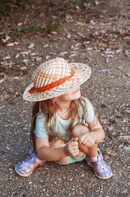 Little girl in a hat by Svetlana Shchemeleva for Stocksy United