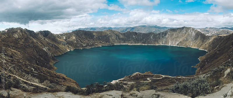 Crater Lake Surrounded by Volcanic Ridges by Oscar Lopez for Stocksy United