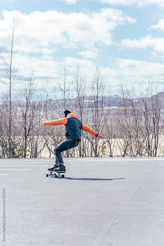 Skateboarding in fall by Søren Egeberg Photography for Stocksy United