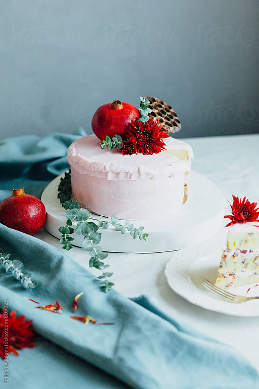 Pomegranate meringue layered cake by Ellie Baygulov for Stocksy United