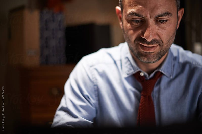 handsome business man working with his laptop by Guille Faingold for Stocksy United