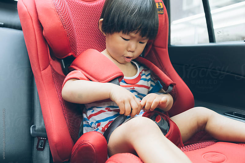 asian little girl(2-3) in a car by unite images for Stocksy United