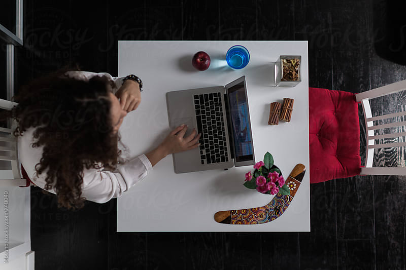 Overhead Shot of a Woman Working on Laptop by Mosuno for Stocksy United