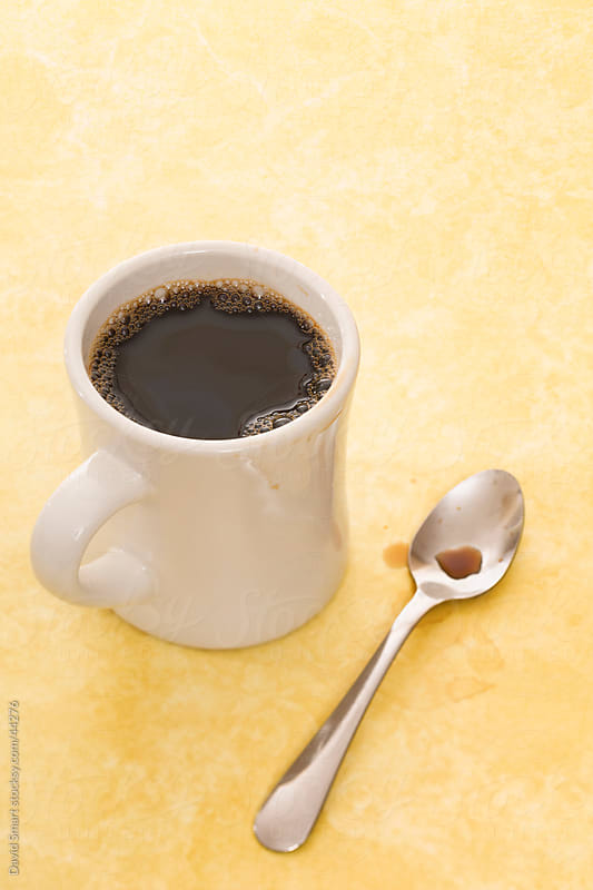 Retro coffee mug and spoon on diner counter by David Smart for Stocksy United
