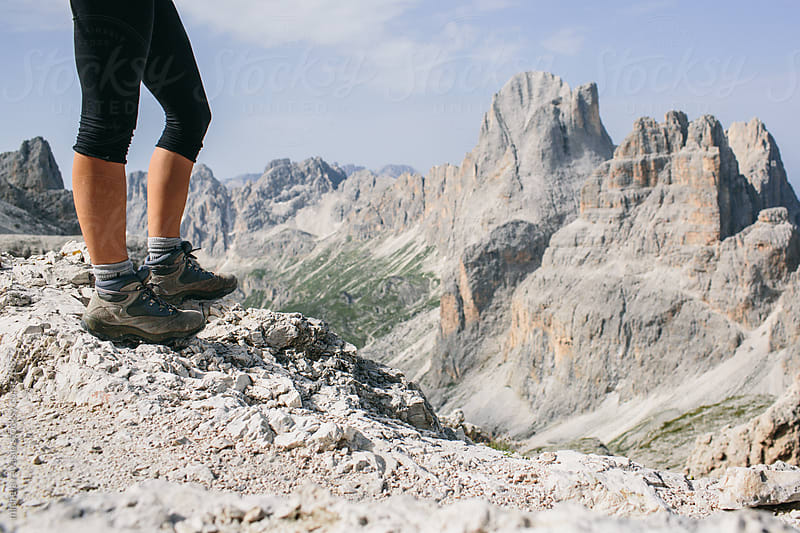 Woman hiking on the top of the mountain by michela ravasio for Stocksy United