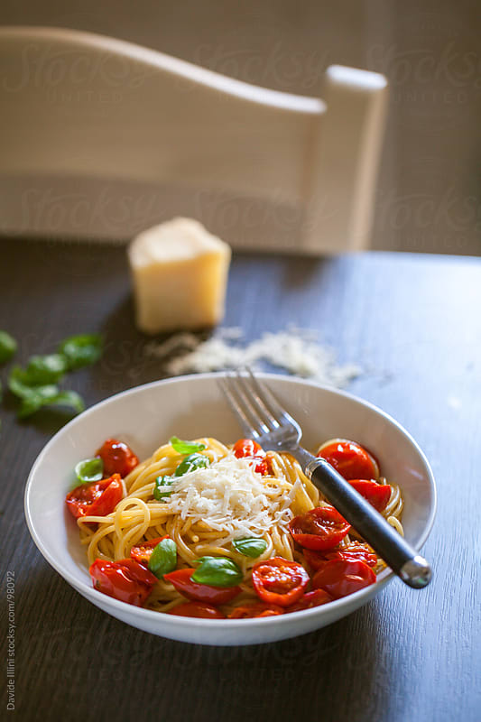 Spaghetti with cherry tomatoes and basil by Davide Illini for Stocksy United