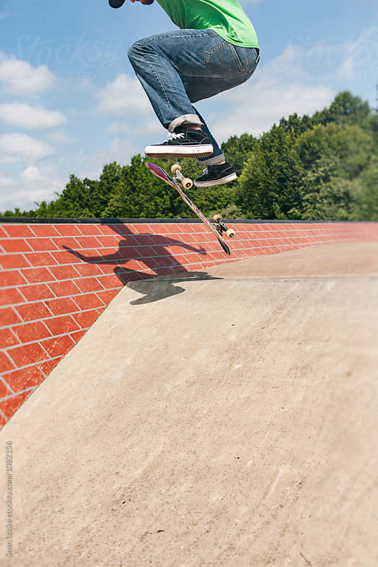 Skateboarder Doing A Flip Trick Before Ramp by Sean Locke for Stocksy United