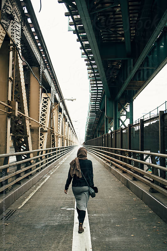 Woman on bridge by Isaiah & Taylor Photography for Stocksy United