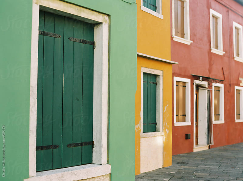 Green, Yellow and Red houses in Burano, Venice by Kirstin Mckee for Stocksy United
