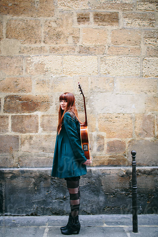 Cute young woman with her guitar by michela ravasio for Stocksy United