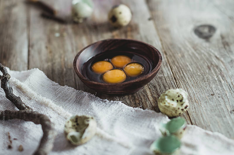 Quail eggs on the table by Tatjana Zlatkovic for Stocksy United