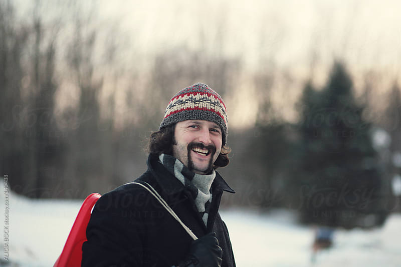 Man With A Sled by ALICIA BOCK for Stocksy United