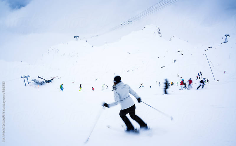 Skiers on the ski slope by J.R. PHOTOGRAPHY for Stocksy United