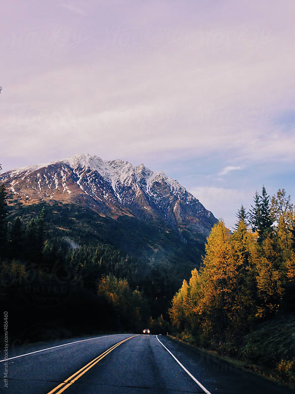 A road in fall by Jeff Marsh for Stocksy United