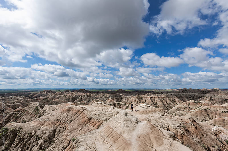 A hiker in Badlands National Park, USA by Adam Nixon for Stocksy United
