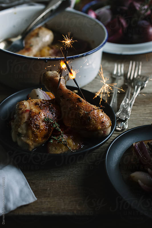 Honey and mustard glazed chicken drumsticks with roasted plums and red onion. by Darren Muir for Stocksy United