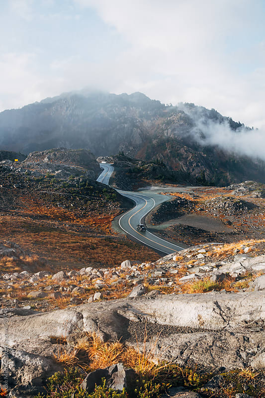 Mountain Road Winding Through Rocky Slopes by Luke Mattson for Stocksy United