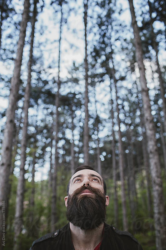 Bearded young man in the center of avenue by Ani Dimi for Stocksy United