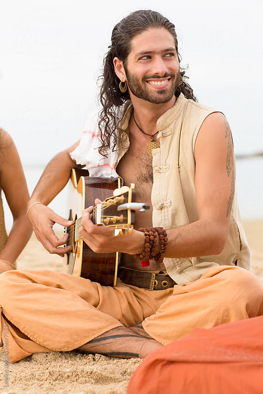 Man Playing the Guitar on the Beach by Lumina for Stocksy United