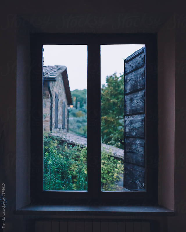 View of farm building from wooden window. Tuscany, Italy by Trent Lanz for Stocksy United