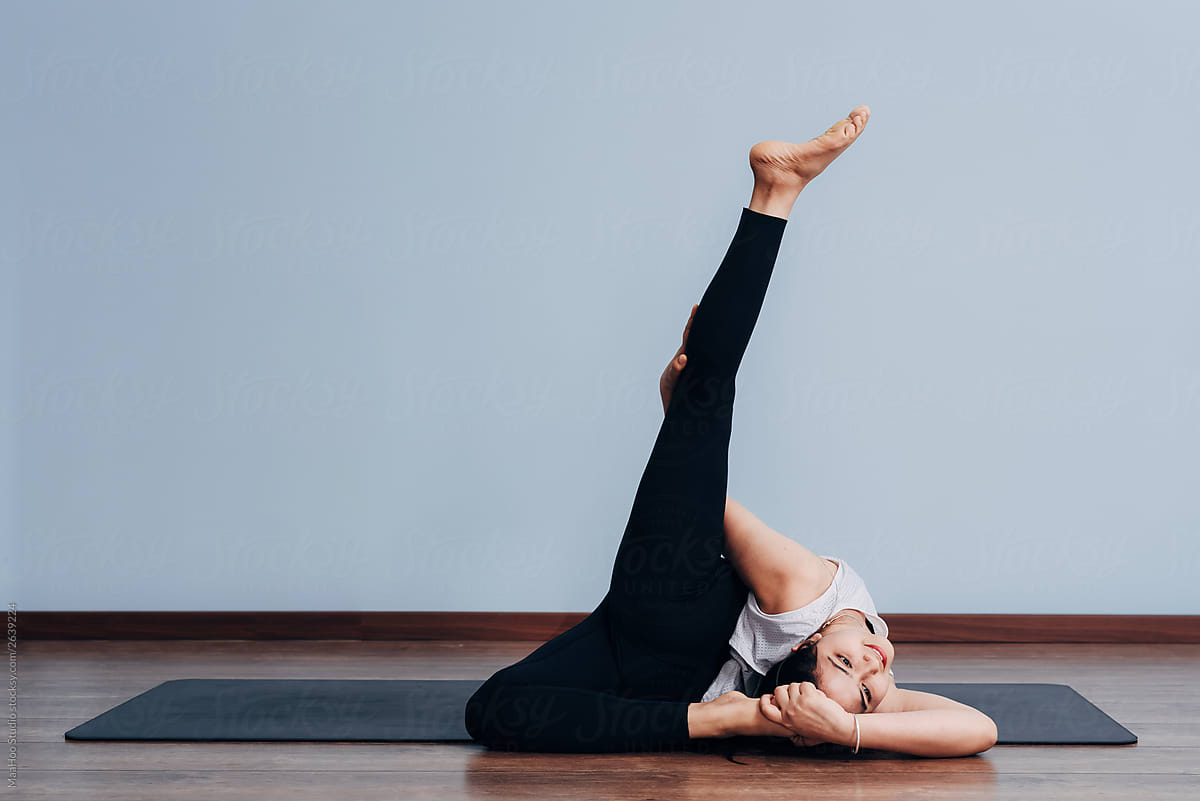 Pretty Sporty Indian Woman Doing Difficult Yoga Pose By Maahoo Studio Yoga India Stocksy United