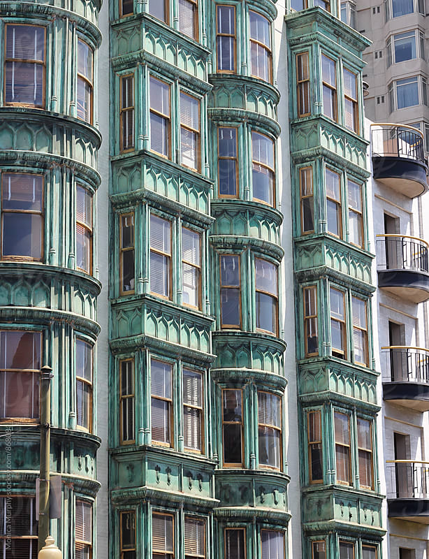 Old building in the city with many windows by Monica Murphy for Stocksy United