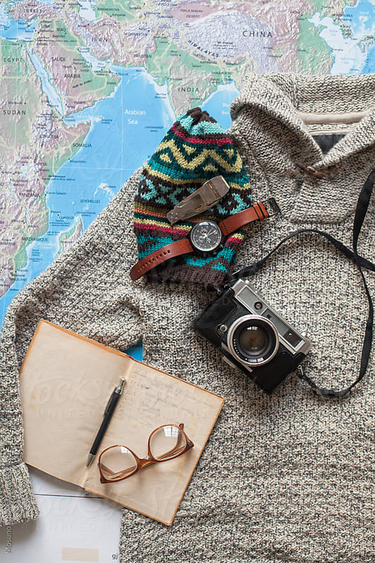 Traveler's Accessories on the Map of the World by Mosuno for Stocksy United