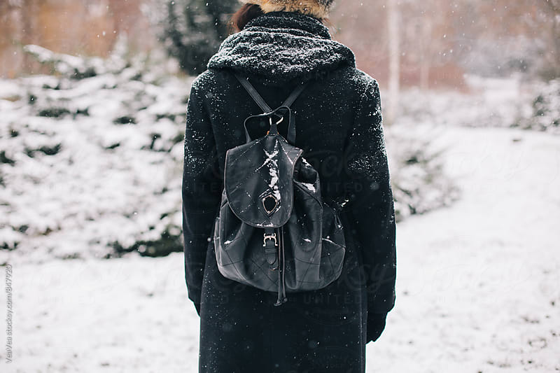 Stylish woman in the park during a snowy day by Marija Mandic for Stocksy United
